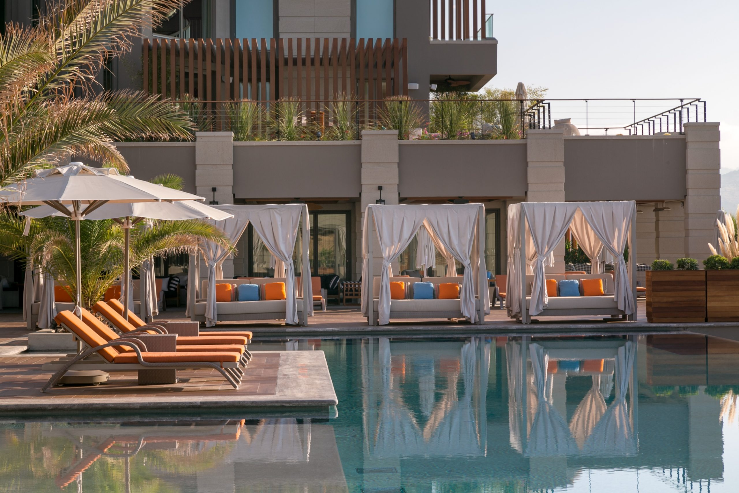 Caresse-Bodrum-Infinity-Pool-Area-Cabanas-Reflections_H-scaled